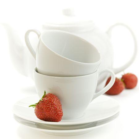 tea time - fresh strawbery, white teacup and teapot on white background Stock Photo - 4955436