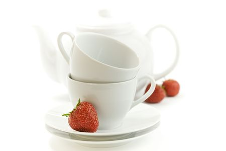 fresh strawberry, white teacup and teapot on white background Stock Photo - 4996476
