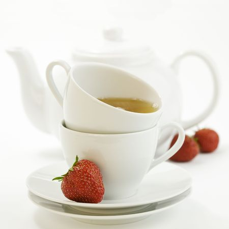 fresh strawberry, white teacup with hot tea and teapot on white background Stock Photo - 5041699
