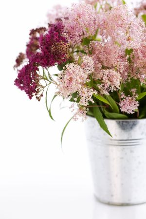 Bouqet of flowers in a pot over white