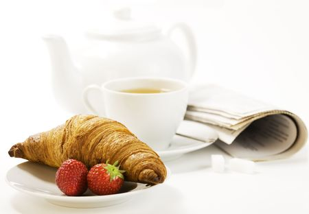 strawberry, croissant, teapot and white teacup with hot tea on white background Stock Photo - 5115303