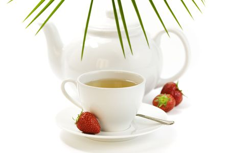 strawberry, croissant,teapot and white teacup with hot tea on white background Stock Photo - 5115251