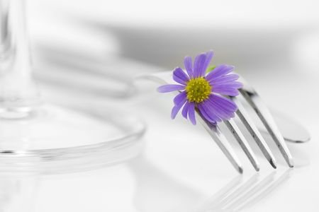 tableware: Place setting with purple flower. Health and diet concept