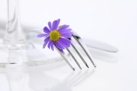inox: Place setting with purple flower. Health and diet concept