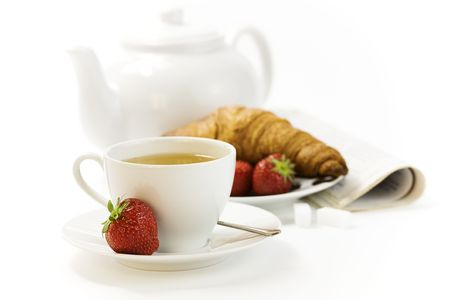 strawberry, croissant, teapot and white teacup with hot tea on white background Stock Photo - 5176183