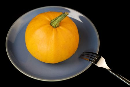 pumpkin on a plate. Conceptual image photo