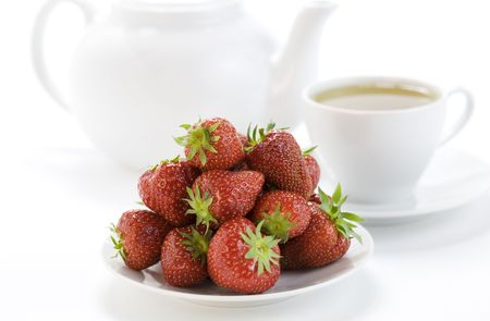 strawberry and white teacup with hot tea on white background Stock Photo - 5238002