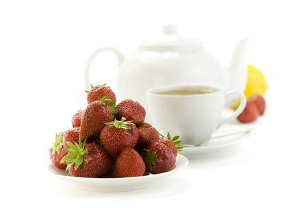 strawberry, lemon, teapot and white teacup with hot tea on white background Stock Photo - 5237937