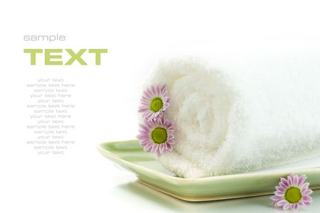 traquility: Towel with flowers on white background