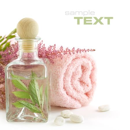 traquility: Jar with fresh leaves and towel (SPA concept) (With sample text) Stock Photo