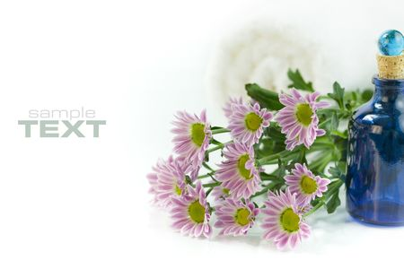 bluer: Spa Bath Towels, essential oil and fresh flowers on white background (With sample text)