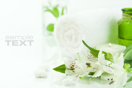 traquility: Candle, flowers and towel (SPA concept) (with sample text) Stock Photo
