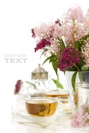 herbal tea, candles and fresh wild flowers over white Stock Photo - 5454646