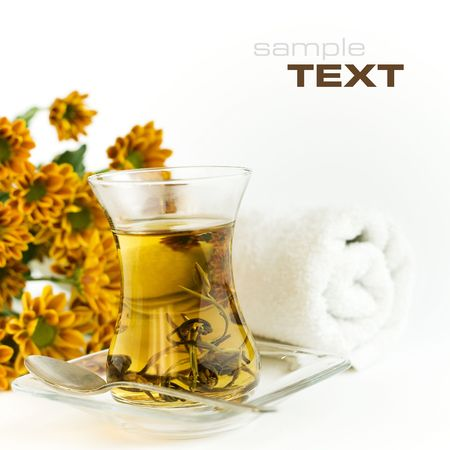 tea towel: Cup of green tea and flowers on a white background Stock Photo
