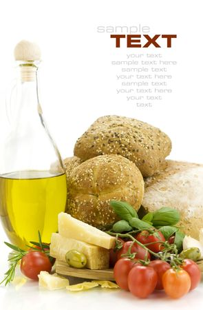Fresh ingredients for an Italian dinner and appetizers over white photo