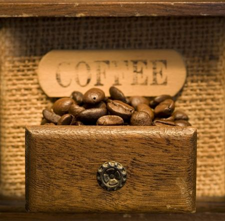 Close up of Antique coffee grinder full of beans