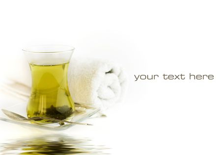 tea towel: Cup of green tea and white towel  reflected in water. With sample text