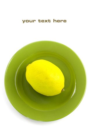 Lemon on a green plate. With sample text Stock Photo - 5793964
