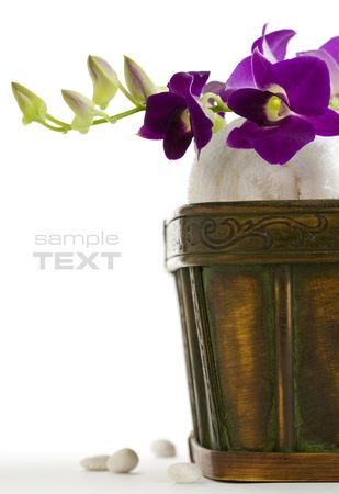 Close up of spa towels with orchids on white. With sample text photo