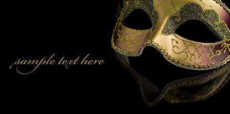 venician: Carnival mask on a black background. The part of mask is reflected by the glass surface (with sample text)