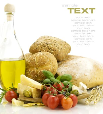 Fresh ingredients for an Italian dinner and appetizers over white. With sample text photo