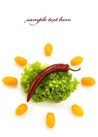 Red hot chili pepper on the leaf of lettuce and cherry tomatoes. With sample text photo