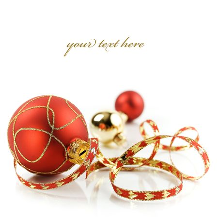 Christmas decorations on white background (with sample text) photo