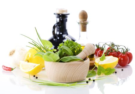 Olive oil, vinegar, Healing herbs and vegetables over white Stock Photo - 5959257