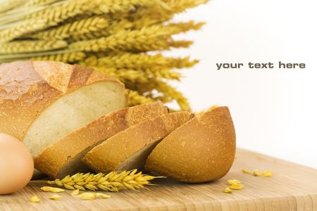 pone: fresh baked bread sliced and grains over white background. With sample text Stock Photo