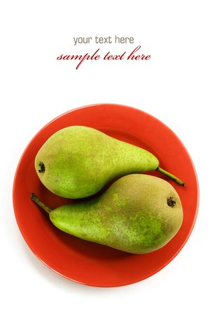 Yin and yang symbol - Two green pears on a red plate over white. With sample text photo
