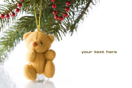 Teddy bear and Christmas decorations on white background photo
