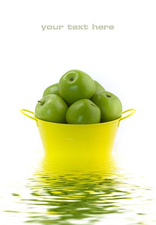 Green apples on a white background with soft focus reflected in the water. With sample text Stock Photo - 6091017