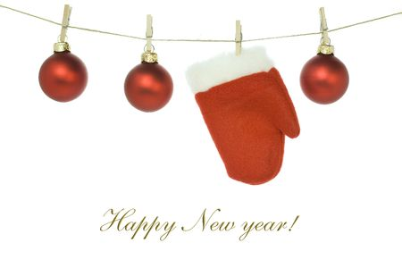 Red santa claus glove and Christmas balls on clothes line (with sample text)   photo