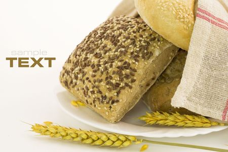 bread composition on white background. With sample text photo