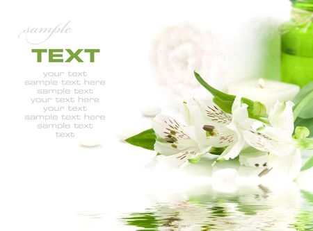 traquility: Candle, flowers and towel (SPA concept) with soft focus reflected in the water. With sample text