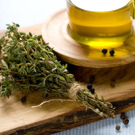 cooking herbs and olive oil on wooden board  photo