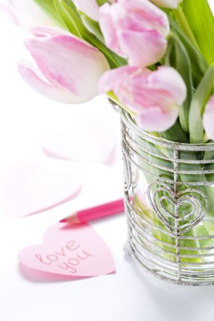 Love message and tulips in busket with hearts. For themes like love, valentines day, mothers day, holidays. photo