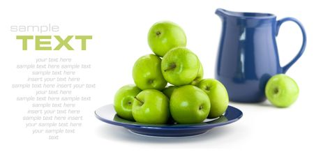 bountiful: Green apples and blue pitcher on white background
