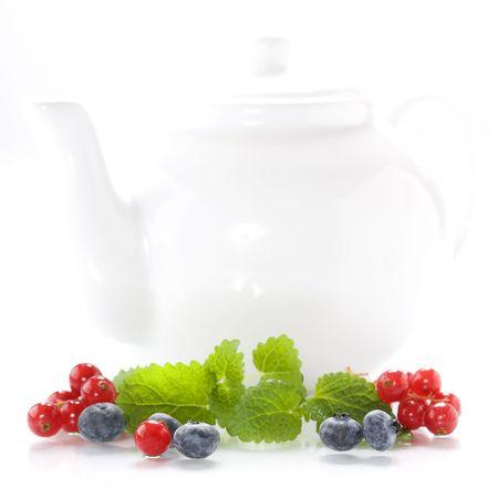 Isolated fresh berries and tea pot photo