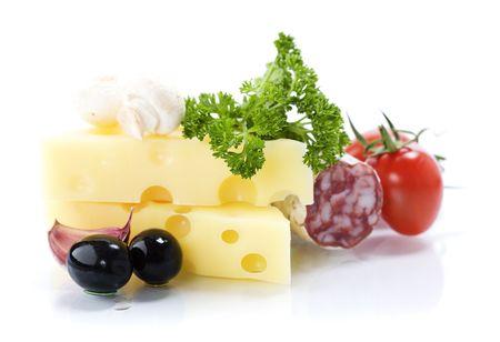 Tasty salami, cheese, tomato, olives and fresh parsley on white background photo
