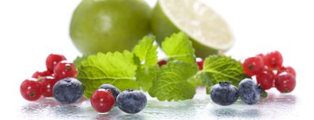 Isolated fresh berries with mint and lime photo