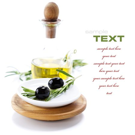 Extra-virgin olive oil and black olives branch (with sample text) photo