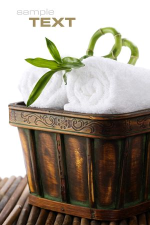beautycare: White towels with green bamboo with sample text