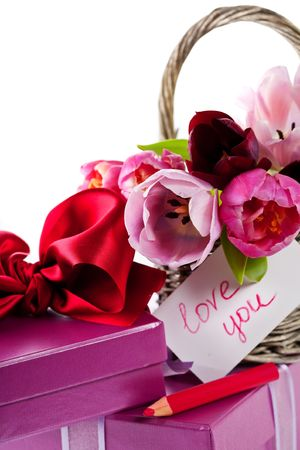 Pink tulips and gift boxes. Selective focus photo