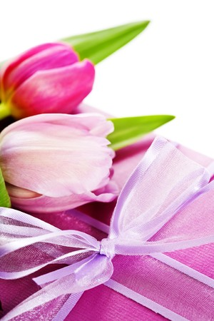 Pink tulips and gift box on a white background photo