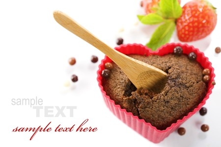 chocolate heart shape muffin in red silicone mold, fresh strawberry  and mint (with sample text) Stock Photo