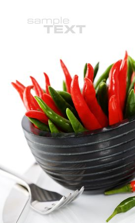 Peppers in plate on white background (with sample text)  Stock Photo