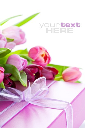 Pink tulips and gift box on a white background. With sample text. photo
