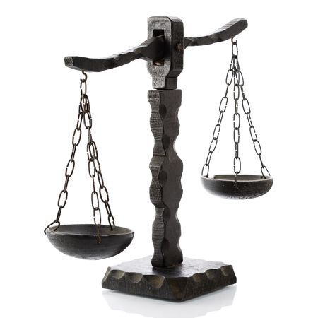 weighing: Justitia horizontal wooden over white Stock Photo