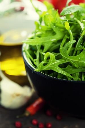 european food: bowl of fresh rucola and fresh ingredients Stock Photo